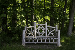 White Wood Bench in Middle of Green Forest Stock Photo