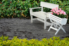White wood chair on floor in garden Stock Photography