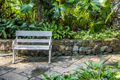 White wood chair in the garden1 Stock Photos