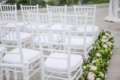White Wood Chiavari Banqueting Chair for wedding, Elegant style, Aisle. Flower, Floral, preparation for wedding ceremony, destination wedding in Koh Samui stock photos