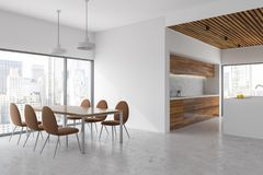White and wood dining room and kitchen, city view Royalty Free Stock Photos