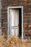 A white wood door standing ajar Royalty Free Stock Images