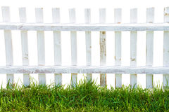 White wood fence and hedge. Royalty Free Stock Photos