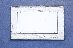 White wood frame. With white space as a text field in a blue wall Stock Photos