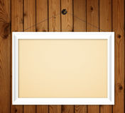 White Wood frame on brown wood Royalty Free Stock Photography