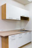White and wood kitchen cabinet Royalty Free Stock Photo
