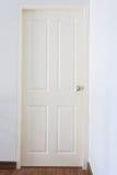White wood pane door closed and silver knob lock Stock Image