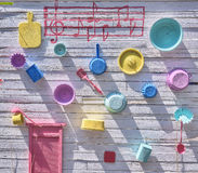 White wood panel with colorful kitchen tools decorations. White wood panel with colorful kitchen decorations royalty free stock photos