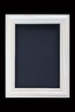 White wood picture frame on black background Royalty Free Stock Photos