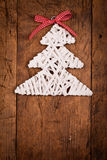 White wood rod Christmas tree wooden table Stock Photo