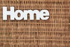 White Wood Sign Home On The Rustic Wicker Background Stock Photography