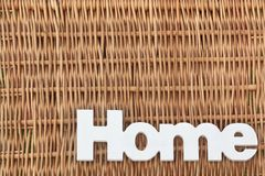 White Wood Sign Home On The Rustic Wicker Background Royalty Free Stock Photo