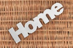 White Wood Sign Home On The Rustic Wicker Background Royalty Free Stock Photography