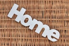 White Wood Sign Home On The Rustic Wicker Background Stock Photo