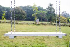 White wood swing. In the garden Stock Photo