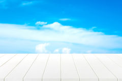 White wood table and blue sky. Royalty Free Stock Images