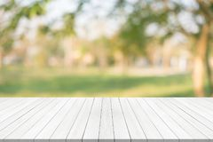 White wood table top on green blurred background,space for montage product royalty free stock image