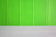 White wood texture table with green leather sofa Royalty Free Stock Image