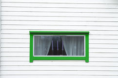 White wood wall green window  three candles Stock Image