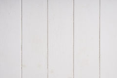 White wood wall paneling background Stock Images