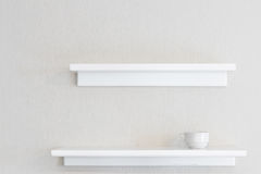 White wood wall shelf. Empty white wood wall shelf and white concrete wall background royalty free stock photography