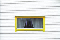 White wood wall yellow window  three candles Stock Photography