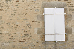 White wood window. Vintage white wood window on the stone wall stock photography