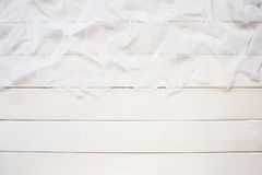 White wooden background with cheesecloth. White wooden background with white cheesecloth Stock Photos