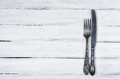 White wooden background with cutlery Stock Image