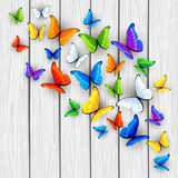 White wooden background with multicolored butterflies Royalty Free Stock Photography