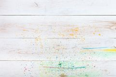 White wooden background with paint splashes, creative wood blank empty table desk plank board. Watercolor artist backdrop, art. Store shop, painting learning stock photo