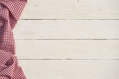 White wooden background with a red checkered tablecloth. White wooden background with red checkered tablecloth Royalty Free Stock Image
