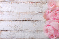 White wooden background with rose pattern border Stock Photography