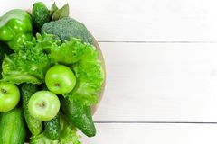 White wooden background with various fresh raw green vegetables. And fruits Stock Photography