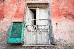 White wooden balcony door and green shutters Stock Images