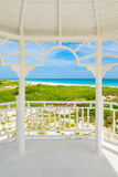 Balcony with a view of  the tropical beach of Varadero in Cuba. White wooden balcony with a view of  the tropical beach of Varadero in Cuba Royalty Free Stock Photos