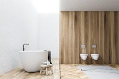 White and wooden bathroom interior, side view. White and wooden wall bathroom interior with a white tub and two toilets. A gray carpet on a wooden floor. 3d Stock Photo