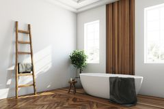 White and wooden bathroom, white tub corner Stock Images
