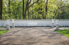 White wooden bench in Lazienki park Stock Images