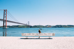 White Wooden Bench Near Body of Water Under Clear Blue Sky Royalty Free Stock Photos