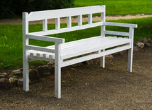 White wooden bench in the park Royalty Free Stock Photo