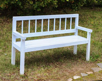 White wooden bench in park Royalty Free Stock Photos