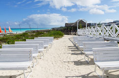 White wooden benches. At the white sandy beach in cayo Santa Maria Cuba Stock Images