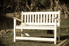White wooden bent near lake,vintage style light. Stock Image