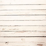 White wooden boards with peeling paint. Background texture of weathered white wooden boards with peeling flaking paint, square format Royalty Free Stock Photos