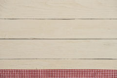 White wooden boards with red checkered tablecloth Stock Photos