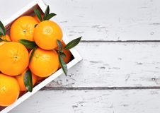 White wooden box with fresh raw organic oranges Stock Images