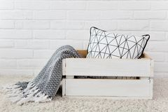 White wooden box pillow plaid. White wooden box with pillow and plaid royalty free stock photo