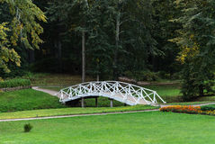 White wooden bridge in old park. White wooden bridge in the old park in the village of Mikhailovskoye, Pushkinsky Reserve, Pskov region, Russia Royalty Free Stock Photo