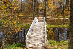 White wooden bridge, the Park of the estate Mikhailovskoye, Pushkinskiye mountains Stock Image
